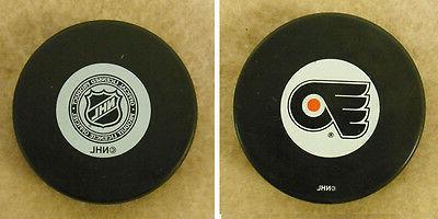 lot of 2 hockey pucks nhl official